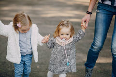 Young family walking in the park Royalty Free Stock Image