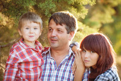 Young family walking in the summer park Royalty Free Stock Photography