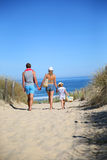 Young family walking to the beach Royalty Free Stock Photo