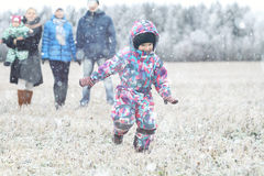 Young family walking in winter field with children Stock Photography