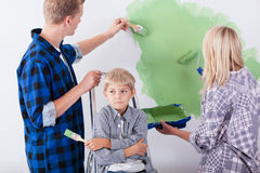 Young family during wall renovation Stock Photos