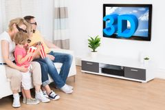 Young family watching 3d tv Stock Photography