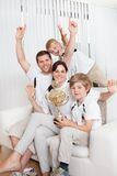 Young family watching football Stock Photo