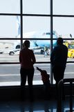 Young family watching planes at an airport Royalty Free Stock Images