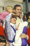 A young family watching the Thanksgiving Parade Stock Photo