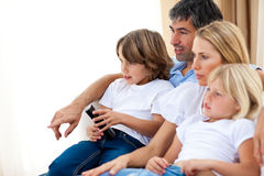 Young Family Watching TV Stock Photography