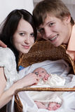 Young family on the white Royalty Free Stock Images