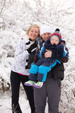 Young family in winter Stock Images