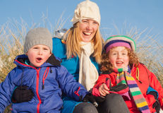 Young family in winter clothing Stock Image