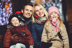 Young family on winter evening royalty free stock images
