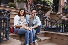 Free Young Family With Kids Sitting On Front Stoops Stock Photos - 108977673