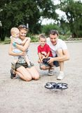 Young Family With Two Boys Playing With RC Toy Royalty Free Stock Photo