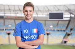 Young fan from France in sports jersey at soccer stadium. Young fan from France in sports jersey of the national team at soccer stadium Royalty Free Stock Photos