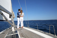 Young fancy couple on sailing trip Stock Photos