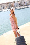 Young fancy girl with suitcase Stock Photography