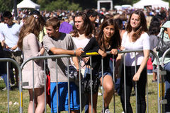 Young Fans at San Francisco Concert. Young female fans of the popular rock group Lifehouse wait behind barricades to catch a glimpse of the musical stars after Stock Photos