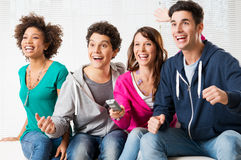 Young Fans Watching Television. Happy Group Of Young Friends Watching Television And Supporting Their Team Stock Photos