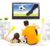 Young fans yelling  and while watching soccer game Stock Images
