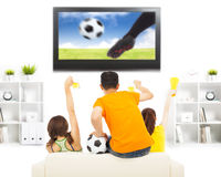 Young fans yelling  and while watching soccer game Stock Photo
