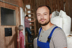 Young farm worker in the barn Royalty Free Stock Photos