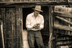 Young Farmer and a Chicken. At the Farm Stock Image