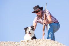 Young farmer with dog Royalty Free Stock Photo