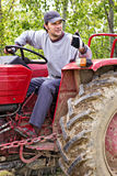 Young farmer driving his tractor and making ok sign Stock Photography