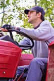 Young farmer driving his tractor Royalty Free Stock Image