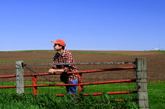 Young farmer at the gate. Royalty Free Stock Images
