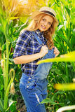 Young farmer girl on corn field. Royalty Free Stock Images