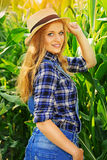Young farmer girl on corn field. Stock Photography