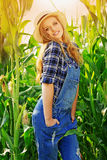 Young farmer girl on corn field. Royalty Free Stock Photo