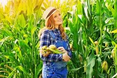 Young farmer girl on corn field. Stock Photo