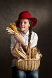 Young farmer girl with a corncob Royalty Free Stock Images