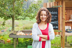 Young farmer girl at food market Royalty Free Stock Images