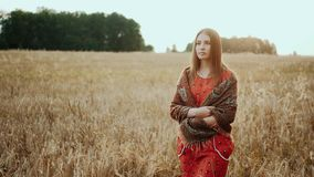 Young farmer girl walking through wheat field at sunset. Modern farming, happy youth and profession concept. Organic stock footage