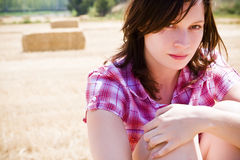 Young farmer with haystacks as background Royalty Free Stock Photography