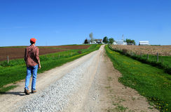 Young farmer headed home royalty free stock photos