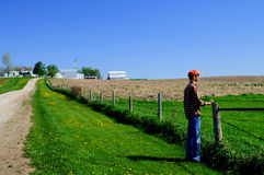 Young farmer at his fence Stock Images