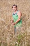 Young farmer in his wheat field Royalty Free Stock Photos
