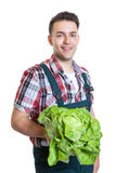 Young farmer with lettuce Royalty Free Stock Images