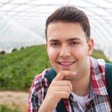 Young farmer looking at camera Stock Image