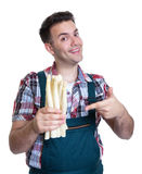 Young farmer pointing to white asparagus Stock Photos