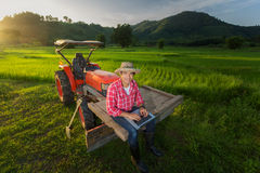 Young Farmer Recorded Growth Of Productivity Sitting On A Tractor. Royalty Free Stock Photo