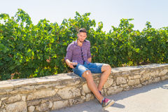 Young farmer tastes a glass of red wine Royalty Free Stock Photography