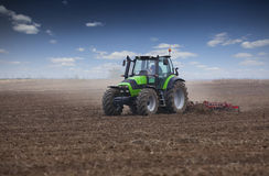 Young farmer in tractor. Preparing land for sowing Royalty Free Stock Photo
