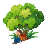 A young farmer under the tree Royalty Free Stock Photography