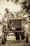 Young Farmer on a Vintage Tractor Royalty Free Stock Photo