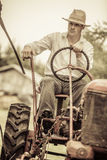Young Farmer on a Vintage Tractor Royalty Free Stock Photos
