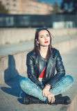 Young fashion beautiful girl in leather jacket outdoor in the ci Royalty Free Stock Images